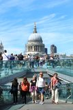Tourists walking on milenium bridge in London Royalty Free Stock Photos