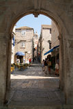 Tourists walking in the narrow alley of Korcula Royalty Free Stock Images