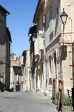 Tourists walking in the narrow streets of Arles Royalty Free Stock Photography