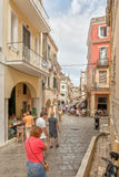 Tourists walking at the narrow streets in city center Royalty Free Stock Images