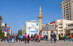 Tourists walking near ancient Camii mosque in Izmir Stock Images