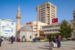 Tourists walking  near ancient mosque, Izmir, Turkey Stock Images