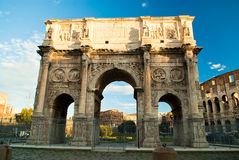 Tourists walking near Constantine's arc in Rome. Triumphal arch in Rome, situated between the Colosseum and the Palatine Hill Stock Images