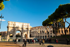 Tourists walking near Constantine's arc in Rome. Triumphal arch in Rome, situated between the Colosseum and the Palatine Hill Stock Image