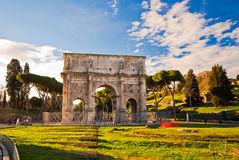 Tourists walking near Constantine's arc in Rome. Triumphal arch in Rome, situated between the Colosseum and the Palatine Hill Royalty Free Stock Photos