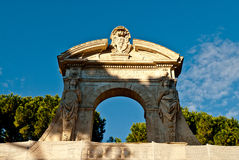 Tourists walking near Constantine's arc in Rome. Triumphal arch in Rome, situated between the Colosseum and the Palatine Hill Royalty Free Stock Photography