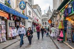 Tourists walking near the gift shops of Montmartre, Paris, France Stock Photos