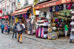 Tourists walking near the gift shops of Montmartre, Paris, France Royalty Free Stock Images