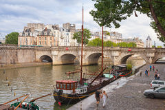 Tourists walking near by Pont Neuf, Paris Royalty Free Stock Photos