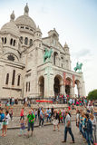Tourists walking near Sacre Coeur Basilica in Paris Royalty Free Stock Images