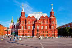 Tourists walking near State Historical Museum building in Moscow Royalty Free Stock Photography