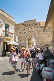 Tourists walking near to the Clock Tower in Taormina, Sicily. TAORMINA, ITALY - JULY, 2, 2015 Royalty Free Stock Photo