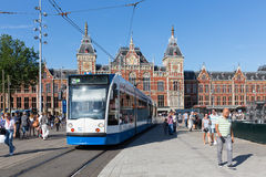 Tourists walking near a tram in Amsterdam Stock Photos
