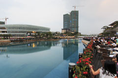 Tourists walking in New Sea World Plaza, one of the landmark of Shenzhen, at sunset Stock Photography