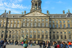 Tourists walking next to Royal Palace in Amsterdam, the Netherla Stock Image