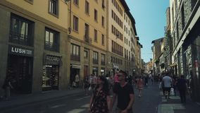 Tourists walking in old Firenze city sightseeing landmarks. Florence, Italy - August 1, 2019: Tourists walking in old Firenze city sightseeing landmarks stock video