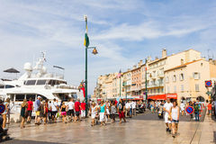 Tourists walking in the old port of Saint Tropez Stock Images