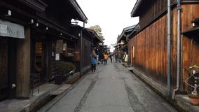 Tourists walking in old town and traditional Japanese village in Takayama.  stock video