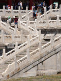 Tourists walking the ornamental stairs leading to one of the mai Stock Photos