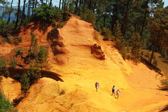 Tourists walking over ochre rocks near French Roussillon Stock Images