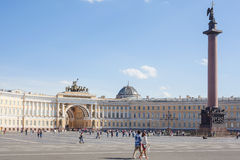 Tourists walking on Palace Square in St.Petersburg. Saint Petersburg, Russia - May 30, 2015: Tourists walking on Palace Square. It is the central city square of Stock Image