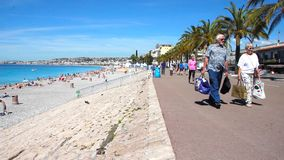 Tourists walking in the Promenade des Anglais in Nice, France stock video footage