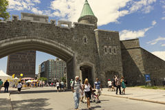 Tourists walking in Quebec near St John gate Stock Photography