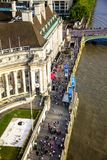 Tourists walking on the River Thames South Bank. London. Aerial view Stock Photo