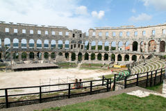 Tourists walking on the ruins of Roman amphitheatre at Pula Stock Photo