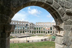 Tourists walking on the ruins of Roman amphitheatre at Pula Stock Photography
