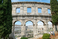 Tourists walking on the ruins of Roman amphitheatre at Pula Stock Image