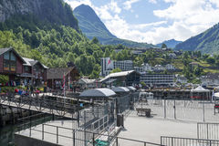 Tourists walking through the seaport quay on June 29, 2016 in Geiranger, Norway. Royalty Free Stock Photos