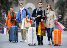 Tourists walking with shopping bags Royalty Free Stock Photo