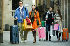 Tourists walking with shopping bags Stock Images