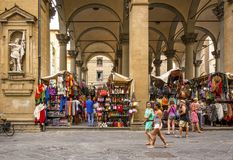 Tourists walking and shopping in the historic Mercato del Porcellino in Florence. Florence, Italy, June 2015: tourists and Florentines walking and shopping in Royalty Free Stock Images