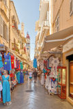 Tourists walking and shopping on narrow streets Stock Photography