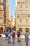 Tourists walking and shopping on narrow streets Royalty Free Stock Photos