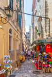 Tourists walking and shopping on narrow streets Royalty Free Stock Images
