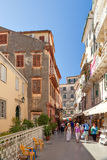 Tourists walking and shopping on narrow streets Royalty Free Stock Image