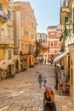 Tourists walking and shopping on narrow streets Royalty Free Stock Photo