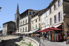 Tourists walking and shopping on the shops of Arles Stock Photos