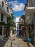Skiathos town Greece. Tourists walking on small narrow streets in skiathos old harbor town. 26 september 2018 royalty free stock photo