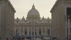 Tourists walking in square near Saint Peter's Basilica church in Vatican City. Stock footage stock video