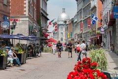 Tourists walking on St Paul Street and visiting Old Montreal in Summer royalty free stock photos