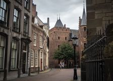 Tourists walking the street behind the Dom Church in Utrecht Royalty Free Stock Image