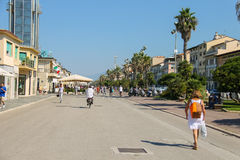 Tourists walking on the street in Viareggio, Italy Royalty Free Stock Image