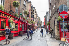 Tourists walking in the Temple Bar, Dublin, Ireland Stock Images