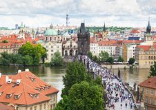 Tourists walking throught Charles Bridge Royalty Free Stock Photography