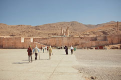 Tourists walking to the great ruined Persepolis city in mountains. UNESCO World Heritage Site Stock Photo