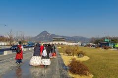 Tourists walking to Gyeongbok Palace,Seoul. Dec 6,2017 Tourists walking to Gyeongbok Palace, Seoul, Korea Stock Photo